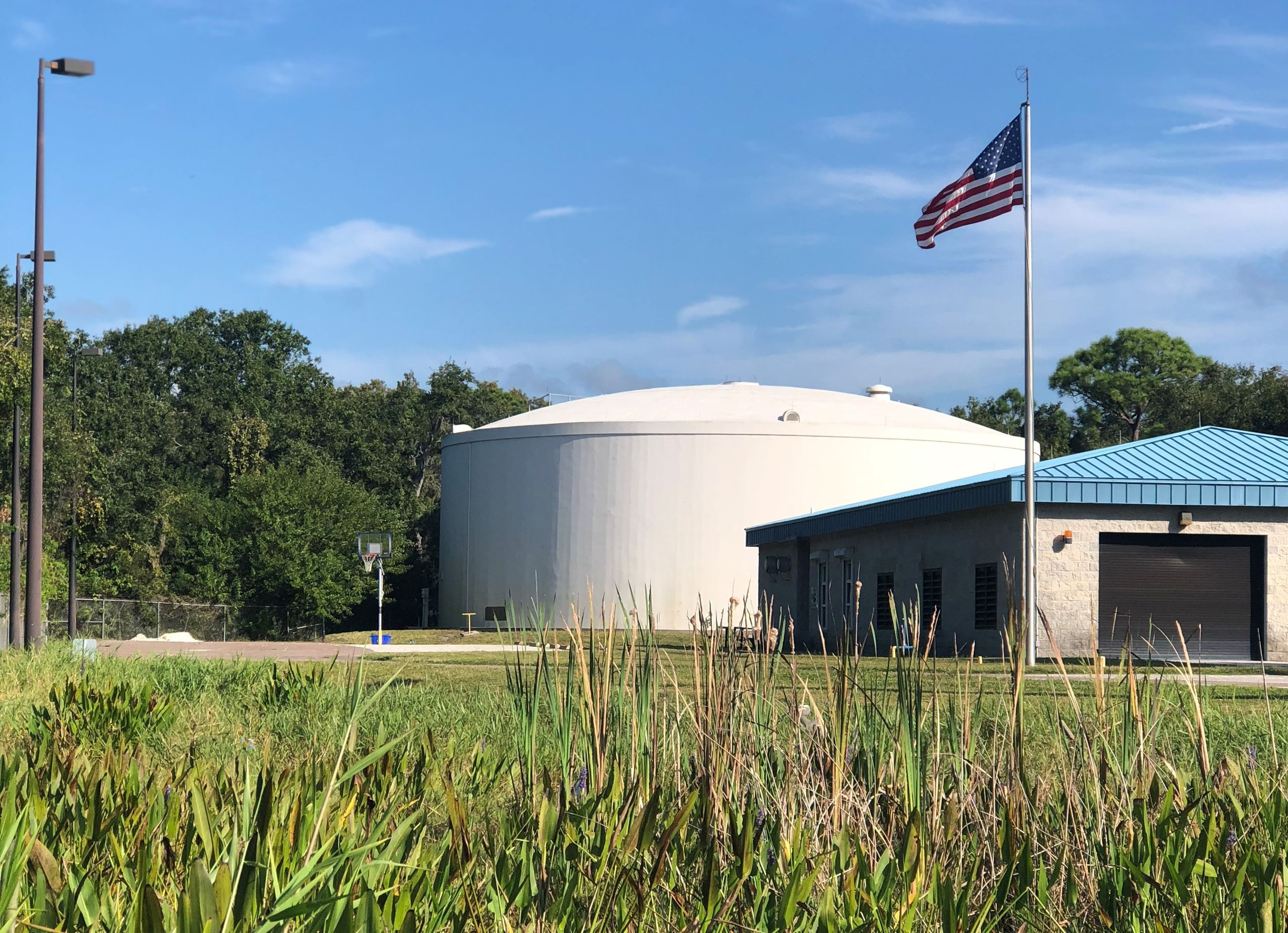 Storage tank and training building