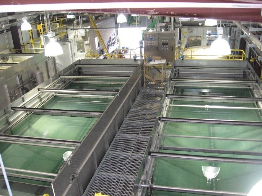 Pictured: Large rectangular vats containing greenish-blue wastewater