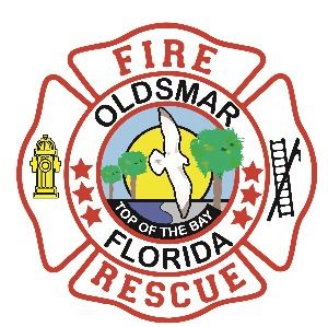 Oldsmar Fire Rescue logo. White background with red fire shield in center. The center features 't
